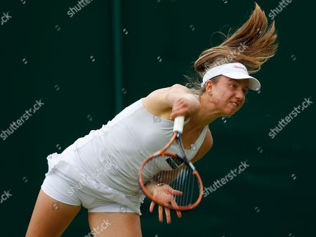 Mona Barthel of Germany serves to Romina Oprandi of Switzerland during their first round match at the All England Lawn Tennis Championships in Wimbledon, London
