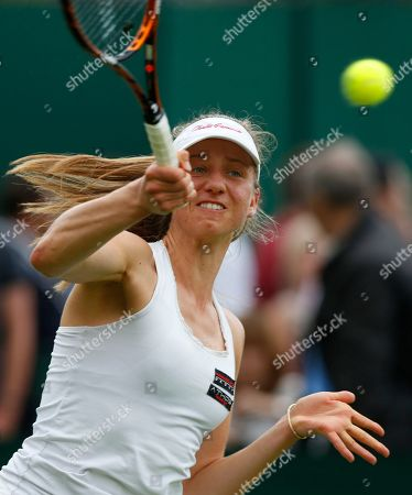 Mona Barthel of Germany returns to Romina Oprandi of Switzerland during their first round match at the All England Lawn Tennis Championships in Wimbledon, London