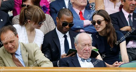 British actor Chiwetel Ejiofor, center, and Sari Mercer, left, talk with British actress Keira Knightley prior to the women's singles final between Eugenie Bouchard of Canada and Petra Kvitova of Czech Republic at the All England Lawn Tennis Championships in Wimbledon, London
