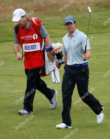 Rory McIlroy of Northern Ireland acknowledges the crowd as he walks with his caddie JP Fitzgerald up to the 18th green during the third day of the British Open Golf championship at the Royal Liverpool golf club, Hoylake, England