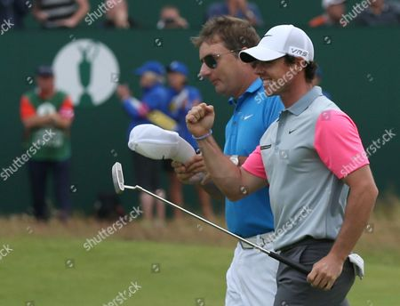 Rory McIlroy of Northern Ireland celebrates winning the British Open Golf championship with his caddie JP Fitzgerald after the final round at the Royal Liverpool golf club, Hoylake, England
