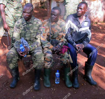 Three defecting fighters from the Lord's Resistance Army rebel group, from left, Sam Opio, Richard Okello and Walube Ojok, sit down for a debriefing session in Central African Republic. The African troops hoped the latest defector from the Lord's Resistance Army rebel group would have something fresh to say about the possible whereabouts of the infamous warlord Joseph Kony. But Sam Opio, a senior rebel commander who defected last week, shook his head and said he hadn't seen rebel leader Kony since 2010. And he is not alone. All recent defectors have denied seeing or communicating with Kony in the last few years, complicating the work of U.S.-backed Ugandan troops who are hunting down rebels in the dense, often-impenetrable jungles of Central Africa. An Associated Press reporter recently trailed soldiers tracking a very small group of rebels