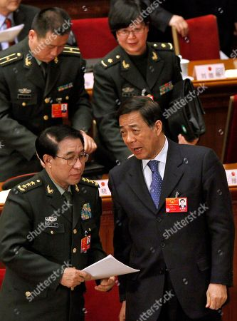 Bo Xilai, Xu Caihou Xu Caihou, bottom left, deputy chairman of the CPC Central Military Commission, which controls China's military, chats with Chongqing party secretary Bo Xilai, bottom right, after a plenary session of the National People's Congress at the Great Hall of the People in Beijing, China. A spreading anti-corruption crackdown launched by President Xi Jinping snared its most senior figure to date on when the former top Chinese general was expelled from the ruling Communist Party to face bribery charges. Gen. Xu, is accused of taking money and property in exchange for promotions and other favors, said a party statement reported by the official Xinhua News Agency. It said his case had been handed over to military prosecutors