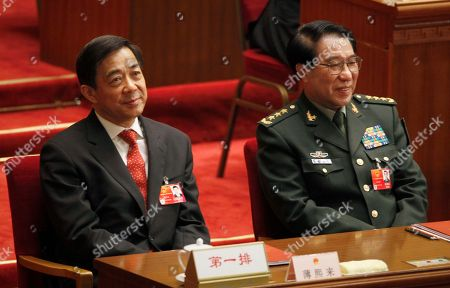 Xu Caihou, Bo Xilai Xu Caihou, right, deputy chairman of the CPC Central Military Commission, which controls China's military, and Chongqing party secretary Bo Xilai attend the closing session of the National People's Congress at the Great Hall of the People in Beijing, China. A spreading anti-corruption crackdown launched by President Xi Jinping snared its most senior figure to date on when the former top Chinese general was expelled from the ruling Communist Party to face bribery charges. Gen. Xu, is accused of taking money and property in exchange for promotions and other favors, said a party statement reported by the official Xinhua News Agency. It said his case had been handed over to military prosecutors