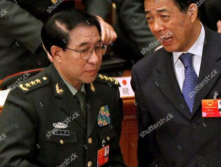 Bo Xilai, Xu Caihou Xu Caihou, left, then deputy chairman of the CPC Central Military Commission, which controls China's military, chats with then Chongqing party secretary Bo Xilai, bottom right, after a plenary session of the National People's Congress at the Great Hall of the People in Beijing, China. Chinese prosecutors have indicted the former top military leader on bribery charges, state media said