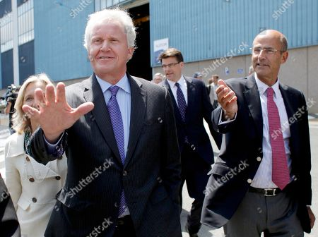 General Electric Co. CEO Jeffrey R. Immelt, GE France chairwoman Clara Gaymard, left rear, and Alstom CEO Patrick Kron, right, arrive at the Alstom plant in Belfort, eastern France, . Alstom's chief executive said the French heavy engineering firm's agreement to sell off most of its power generation business to U.S. rival General Electric Co. will save jobs and protect France's national interests. The $17 billion deal was agreed over the weekend after weeks of international negotiations that reached the highest levels of French politics