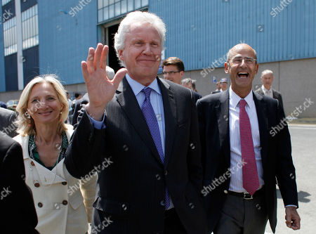 General Electric Co. CEO Jeffrey R. Immelt, center, GE France chairwoman Clara Gaymard, left, and Alstom CEO Patrick Kron, right, arrive at the Alstom plant in Belfort, eastern France, . Alstom's chief executive said the French heavy engineering firm's agreement to sell off most of its power generation business to U.S. rival General Electric Co. will save jobs and protect France's national interests. The $17 billion deal was agreed over the weekend after weeks of international negotiations that reached the highest levels of French politics