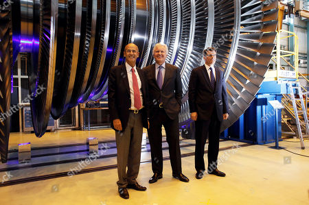 General Electric Co. CEO Jeffrey R. Immelt, center, CEO of GE Power & Water Steve Bolze, right, and Alstom CEO Patrick Kron, left, pose inside the Alstom plant in Belfort, eastern France, . Alstom's chief executive said the French heavy engineering firm's agreement to sell off most of its power generation business to U.S. rival General Electric Co. will save jobs and protect France's national interests. The $17 billion deal was agreed over the weekend after weeks of international negotiations that reached the highest levels of French politics