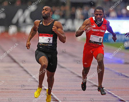 U.S. Tyson Gay, left, on his way to win the 100m men's race, ahead of Richard Thompson, right, from Trinida and Tobago, during the Athletics Montreuil meeting at the Jean Delbert stadium, in Montreuil, east of Paris, France, . Tyson Gay clocked 10.04