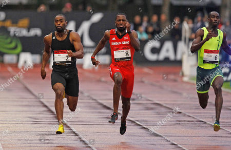 U.S. Tyson Gay, left, on his way to win the 100m men's race, ahead of Richard Thompson, center, from Trinida and Tobago, and Norway's Jaysuma Saidy-Ndure, right, during the Athletics Montreuil meeting at the Jean Delbert stadium, in Montreuil, east of Paris, France