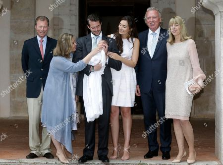 From left, Grand Duke Henri and Grand Duchess Maria-Teresa of Luxembourg, pose with their son Prince Felix holding his daughter Princess Amalia, and his wife Princess Claire of Luxembourg, center, with Hartmut and Gabriele Lademacher, at right, parents of Claire of Luxembourg, after the baptism ceremony of Princess Amalia, at the Saint Ferreol Chapel in Lorgues, southeastern France