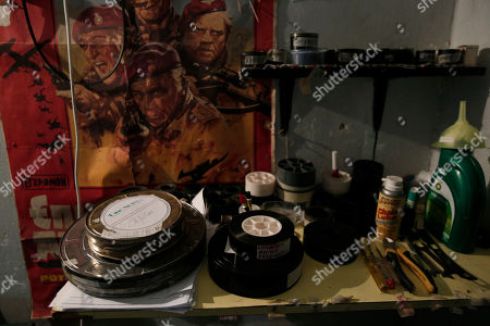Film and tools lie on a table next to a poster of the 1978 war movie Wild Geese, starring Richard Burton, at the Amigo outdoor cinema in Halandri, north of Athens. Cinema projectionists may soon become obsolete with the global switchover from analog to digital projection