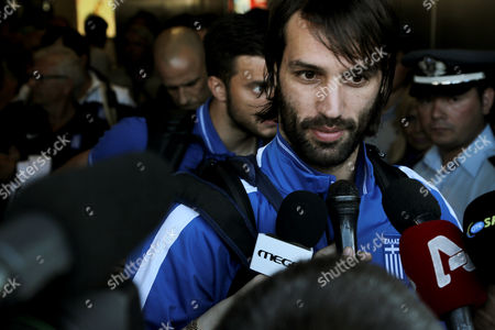"""Georgios Samaras Greece soccer player Georgios Samaras arrives with his teammates at the """"Eleftherios Venizelos"""" airport in Athens from Brazil after Greece World Cup 2014 elimination in a penalty shootout loss to Costa Rica, on . Costa Rica beat Greece in a penalty shootout Sunday to reach the World Cup quarterfinals for the first time after defending desperately with 10 men for nearly an hour. Greece's Gekas saw his penalty saved by Costa Rica goalkeeper Keylor Navas for the only miss in the shootout"""