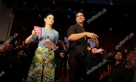 Akshay Kumar, Tamannaah Bhatia Bollywood actors Akshay Kumar, right, and Tamannaah Bhatia throw compact discs of songs from their upcoming movie 'Entertainment' during an promotional event at a college in Bangalore, India, . The slapstick comedy movie is scheduled to be released on Aug. 8