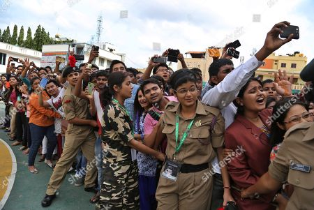 Students of Garden City college struggle to get a glimpse of Bollywood actors Akshay Kumar and Tamannaah Bhatia after the actors arrived in the college to promote their upcoming movie 'Entertainment' in Bangalore, India, . The slapstick comedy movie is scheduled to be released on Aug. 8