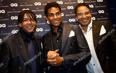 3T group members from left, Taj, TJ and Taryll, nephews of late Michael Jackson, pose as they attend a presentation of designer Angelo Galasso men's Spring-Summer 2015 collection, part of the Milan Fashion Week, unveiled in Milan, Italy