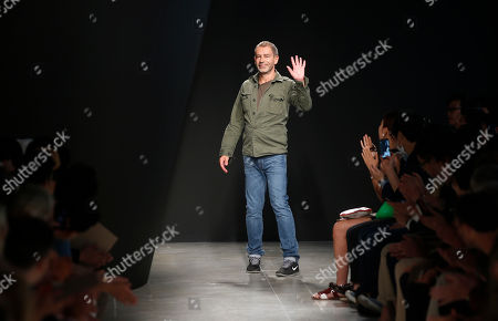 Tomas Maier German designer Tomas Maier acknowledges the applause at the end of the presentation of the Bottega Veneta men's Spring-Summer 2015 collection, part of the Milan Fashion Week, unveiled in Milan, Italy