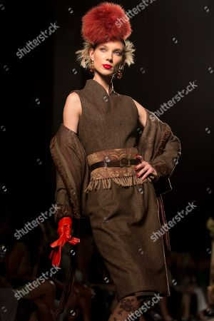 A model wears a creation part of Italian fashion house Raffaella Curiel Fall-Winter 2014 high fashion collection, unveiled in Rome