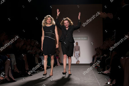 Raffaella Curiel, right, flanked by her daughter Gigliola acknowledge the applause at the end their Fall-Winter 2014 high fashion collection, in Rome