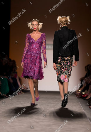 Models wear creations part of Italian fashion house Raffaella Curiel Fall-Winter 2014 high fashion collection, unveiled in Rome