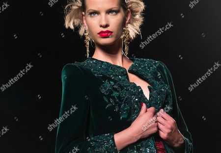 A model wears a creation part of Italian fashion house Raffaella Curiel Fall-Winter 2014 high fashion collection unveiled in Rome