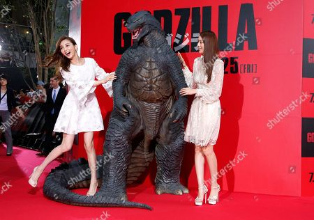 "Moe Oshikiri, Yuri Ebihara Japanese models Moe Oshikiri, left, and Yuri Ebihara pose for photographers during the Japan premiere of ""Godzilla"" in Tokyo"