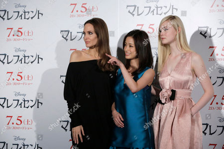 """Stock Picture of Angelina Jolie, Aya Ueto, Elle Fanning Angelina Jolie, left, Japanese actress Aya Ueto, center, and U.S. actress Elle Fanning, right, pose for photographers at the photo call of """"Maleficent"""" in Tokyo"""