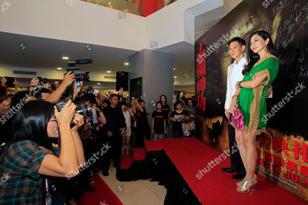 """Nick Cheung, Carrie Ng Hong Kong actors Carrie Ng, right, and Nick Cheung pose for photographers as they attend the premiere of their movie """"Hungry Ghost Ritual"""" in Petaling Jaya, near Kuala Lumpur, Malaysia"""
