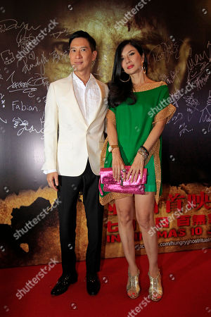 """Nick Cheung, Carrie Ng Hong Kong actors Nick Cheung, left, and Carrie Ng pose for photographers as they attend the premiere of their movie """"Hungry Ghost Ritual"""" in Petaling Jaya, near Kuala Lumpur, Malaysia"""
