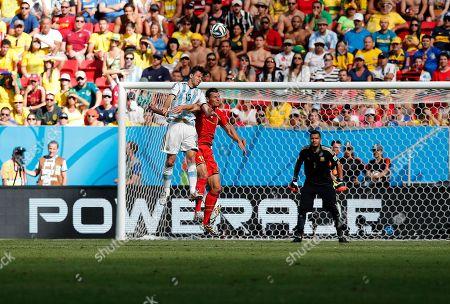 Martin Demichelis,Daniel Van Buyten Argentina's Martin Demichelis (15) goes over the top of Belgium's Daniel Van Buyten (15) during the World Cup quarterfinal soccer match at the Estadio Nacional in Brasilia, Brazil