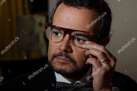 """Aleks Syntek Mexican singer Aleks Syntek adjusts his glasses as he listens to a reporter's question during a press conference to promote his newest album, """"Romantico Desliz,"""" at the W Hotel in Mexico City, . Syntek has been a professional musician for 25 years and """"Romantico Desliz,"""" is his 10th album"""