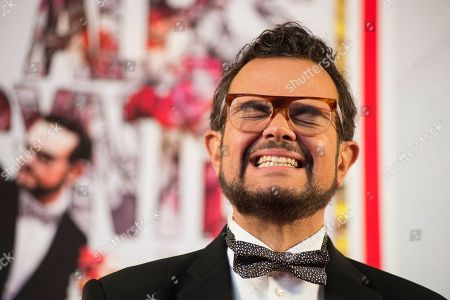"""Aleks Syntek Mexican singer Aleks Syntek pauses before responding to a reporter's question at a press conference to promote his newest album, """"Romantico Desliz,"""" at the W Hotel in Mexico City, . Syntek has been a professional musician for 25 years and """"Romantico Desliz,"""" is his 10th album"""