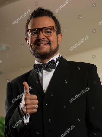 """Aleks Syntek Mexican singer Aleks Syntek, greets reporters with a thumbs up at a press conference to promote his newest album, """"Romantico Desliz,"""" at the W Hotel in Mexico City, . Syntek has been a professional musician for 25 years and """"Romantico Desliz,"""" is his 10th album"""