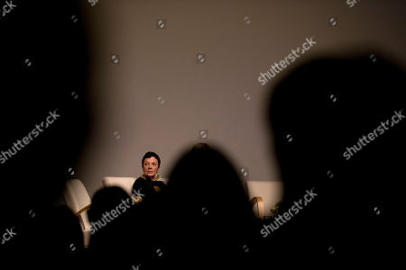 Graciela Iturbide Mexican photographer Graciela Iturbide is seen through silhouetted members of the crowd, as she listens to speeches about her work at a ceremony where she was awarded the 2014 Medal of Fine Arts, at the Palace of Fine Arts in Mexico City, . Iturbide, one of Mexico's best known photographers, was recognized with Mexico's highest arts award Thursday