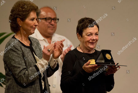 Graciela Iturbide, Maria Cristina Garcia Cepeda, Alfonso Morales Mexican photographer Graciela Iturbide, right, is applauded by Maria Cristina Garcia Cepeda, left, director of Mexico's National Institute of Fine Arts, and Alfonso Morales, historian and photo magazine director, after Iturbide was presented with the 2014 Medal of Fine Arts, at the Palace of Fine Arts in Mexico City, . Iturbide, one of Mexico's best known photographers, was recognized with Mexico's highest arts award Thursday