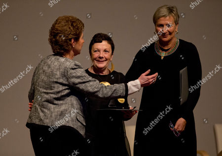 Graciela Iturbide, Fabienne Bradu Mexican photographer Graciela Iturbide, center, is congratulated by writer and friend Fabienne Bradu, right, and Maria Cristina Garcia Cepeda, director of Mexico's National Institute of Fine Arts, after receiving the 2014 Medal of Fine Arts, at the Palace of Fine Arts in Mexico City, . Iturbide, one of Mexico's best known photographers, was recognized with Mexico's highest arts award Thursday