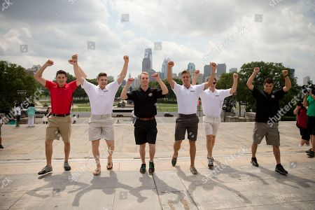 """Stock Photo of Michael Dal Colle, Leon Draisaitl, Samuel Bennett, Aaron Ekblad, Sam Reinhart, Anthony DeAngelo NHL prospects from left, Michael Dal Colle, Leon Draisaitl, Samuel Bennett, Aaron Ekblad, Sam Reinhart, and Anthony DeAngelo, imitate for photographers the character Rocky Balboa from the 1976 movie """"Rocky,"""" on the steps of the Philadelphia Museum of Art, in Phildelphia. The NHL hockey draft is scheduled for June 27th and 28th"""
