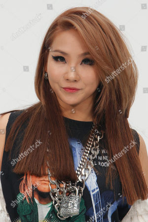 Member of the South Korean K-Pop girl group 2NE1 Lee Chae-rin poses for photographers as she arrives for Chanel Fall-Winter 2014-2015 Haute Couture fashion collection, in Paris