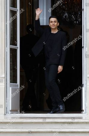 Fashion designer Rad Hourani waves after the presentation of his fall-winter 2014-2015 Haute Couture fashion collection in Paris, France