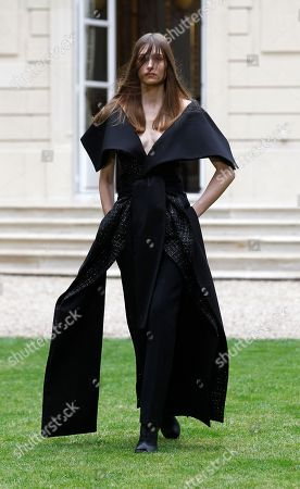 A model wears a creation for Rad Hourani's fall-winter 2014-2015 Haute Couture fashion collection presented in Paris, France