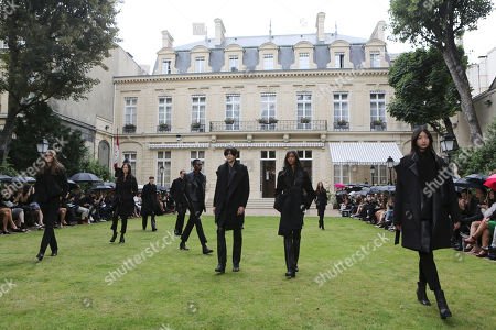 Models present creations for Rad Hourani's fall-winter 2014-2015 Haute Couture fashion collection presented in Paris, France