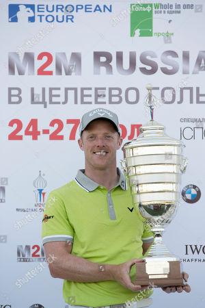 David Horsey Britain's David Horsey holds his trophy after the winning in the final round at the M2M Russian Open golf tournament at Tseleevo Golf and Polo Club outside Moscow, Russia, . Horsey sensationally forced and won a play-off with Damien McGrane to take the M2M Russian Open at Tseleevo Golf & Polo Club