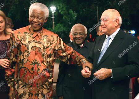 F.W. de Klerk, Nelson Mandela, Desmond Tutu Former South African presidents Nelson Mandela, left, and FW de Klerk, right, with Anglican Archbishop Desmond Tutu, center, at de Klerk's 70th birthday party in Cape Town, South Africa. A new documentary film to be released, focuses on de Klerk who was the country's last white president and who, together with Mandela, plotted the historic transition to a multi-racial democracy, for which they were jointly awarded the Nobel Peace Prize in 1993