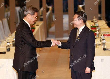 Zhang Zhijun, Wang Yu-chi Zhang Zhijun, minister of Beijing's Taiwan Affairs Office, left, and his Taiwan counterpart Wang Yu-chi shake hands at the start of their meeting in Taoyuan, Taiwan, . China has sent Zhang, its first ever ministerial-level official to Taiwan for four days of meetings to rebuild ties with the self-ruled island that Beijing claims as its own, after mass protests in Taipei set back relations earlier this year