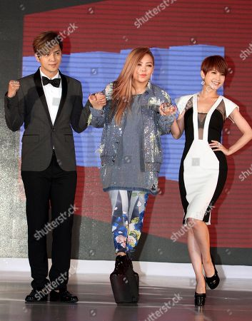 Stock Picture of A-mei, Rainie Yang, Show Lo Taiwanese singers, from left, Show Lo, A-mei and Rainie Yang pose for photographers during a media event to announce they join EMI Music, in Taipei, Taiwan