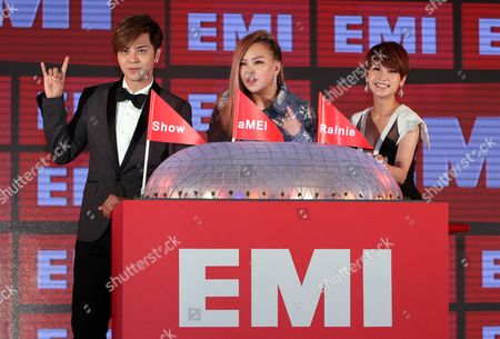 Stock Photo of A-mei, Rainie Yang, Show Lo Taiwanese singers, from left, Show Lo, A-mei and Rainie Yang pose for photographers during a media event to announce they join EMI Music, in Taipei, Taiwan