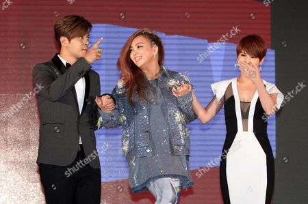 Stock Image of A-mei, Rainie Yang, Show Lo Taiwanese singers, from left, Show Lo, A-mei and Rainie Yang join their hands during a media event to announce they join EMI Music, in Taipei, Taiwan
