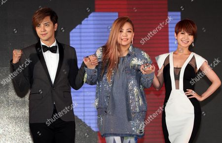 A-mei, Rainie Yang, Show Lo Taiwanese singers, from left, Show Lo, A-mei and Rainie Yang pose for photographers during a media event to announce they join EMI Music, in Taipei, Taiwan