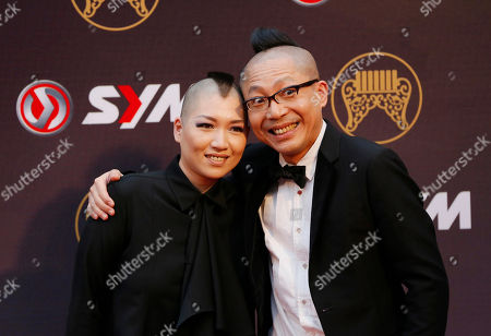 Li Cheng-fan Taiwanese composer Li Cheng-fan, right, and his wife Li Wang Ruo-han pose for photographers as they arrive at the 25th Golden Melody Awards in Taipei, Taiwan