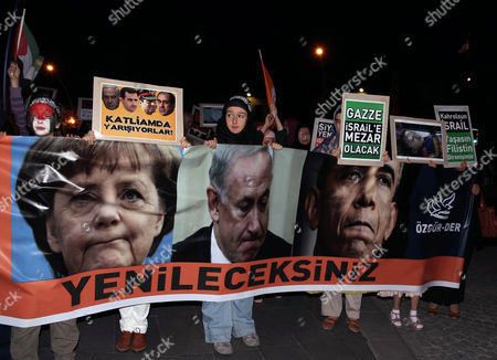 "Stock Image of Pro-Palestinian Turks stage a protest rally against Israel's ground operation in Gaza Strip, outside the US embassy in Ankara, Turkey, late . Turkish Prime Minister Recep Tayyip has intensified Saturday his fiery rhetoric against Israel over its ground invasion of Gaza, accusing the country of ""state terrorism"" and ""genocide."" The banner with images of US President Barack Obama, Israeli Prime Minister Binyamin Netanyahu and German Chancellor Angela Merkel reads: "" You will be defeated."" Placard to the left reads "" They are racing toward savagery!"", and to the right, "" Palestine will be Israel's grave"